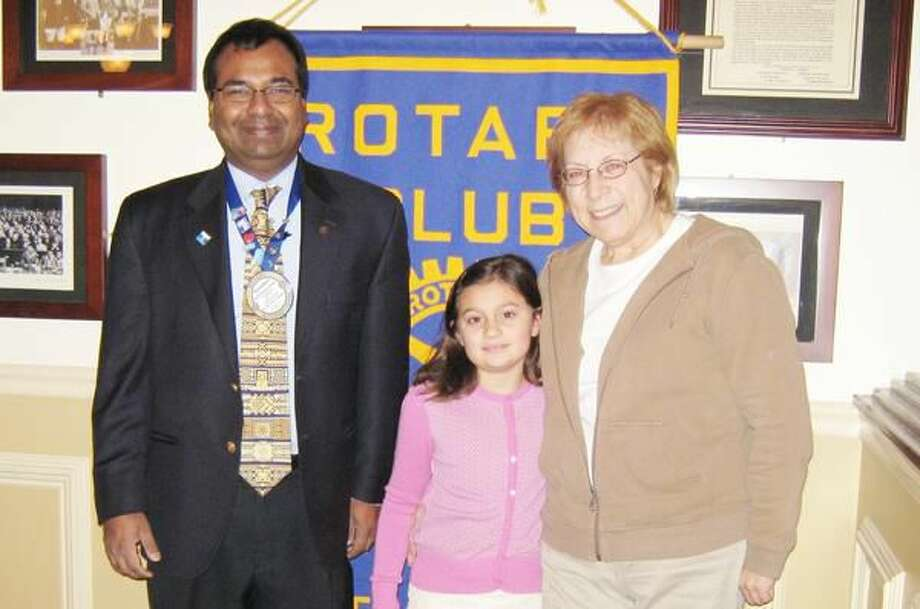 Submitted Photo Alyssa Cyr, a second grade student at Hamden's Ridge Hill School, has been named The Rotary Club of Hamden's Student of the Month for February. Shown with the recipient are Rotarian Mohammad Elahee and Alysa's teacher, Marilyn Gandelman.