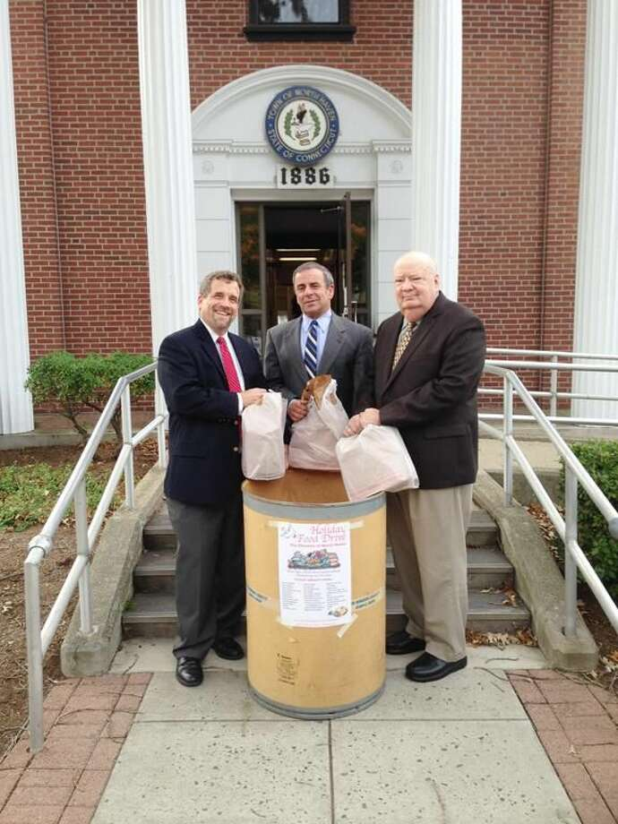 Submitted Photo by Valerie Goodkin Left to Right, Reverend Scott Morrow, First Selectman Michael J. Freda, and Town of North Haven Welfare Administrator Dan Riccio.