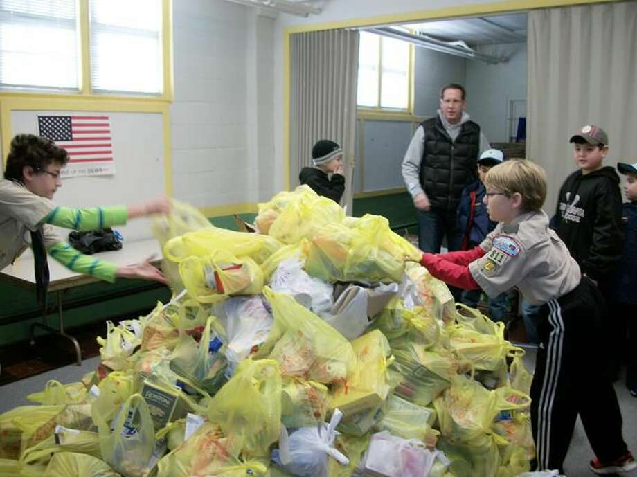 Photo by Lynn Fredricksen Members of Boy Scout troops 800, 810 and 811 and Cub Scouts pack 810 worked hard to collect non-perishable food donations to stock the food pantry shelves in time for Thanksgiving and Christmas food distribution to needy families.