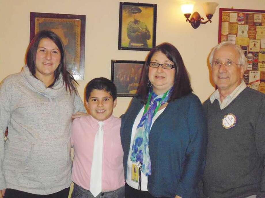 Submitted Photo From left, teacher Tiffany Cofrin,Domenico Sposito, Principal Stacie D'Antonio and Hamden Rotary Club President Lee Campo.