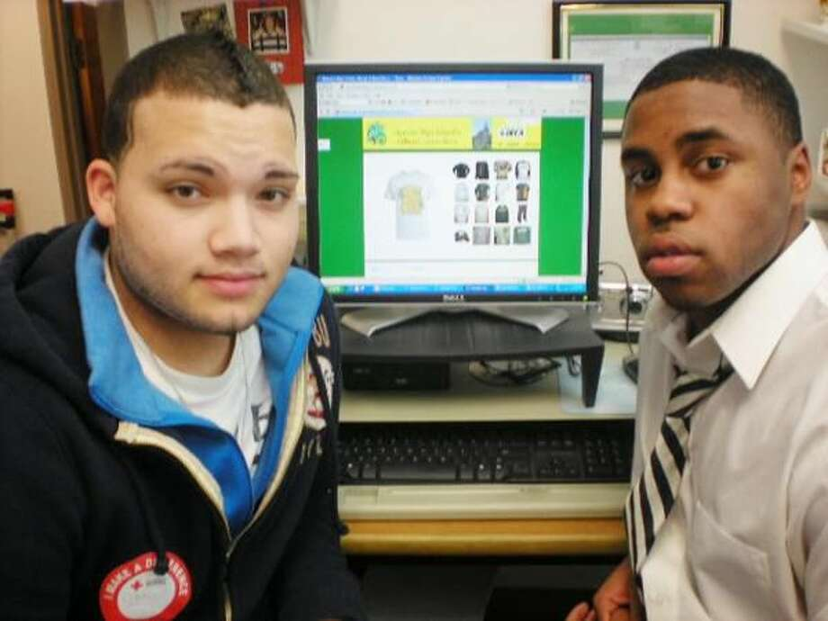Submitted Photo Christian Reyes (left) and Matthew Rogers (right) in front of a computer with the online school store Web site open.