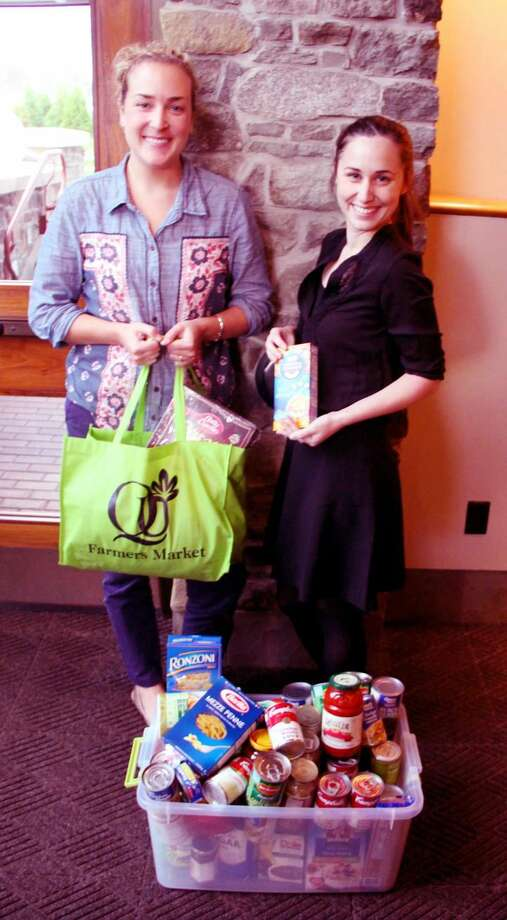 Submitted Photo Bonnie Shea, left, an administrative assistant, and Claire Puzarne, assistant to the executive director of Ireland's Great Hunger Museum at Quinnipiac University, were among the Quinnipiac employees who worked on a food drive to benefit the Connecticut Food Bank.
