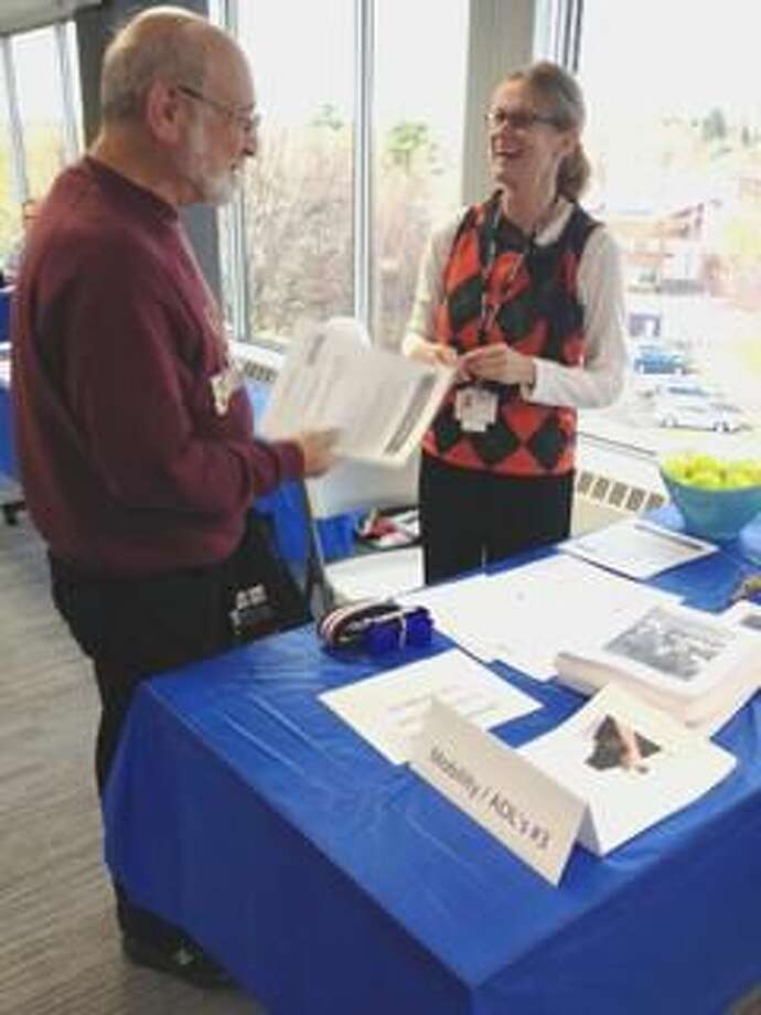 Submitted Photo Jane Kircaldie, PT from VNA Community Healthcare, speaks with a family caregiver at the recent Family Caregiver School Open House held by the nonprofit home healthcare agency.