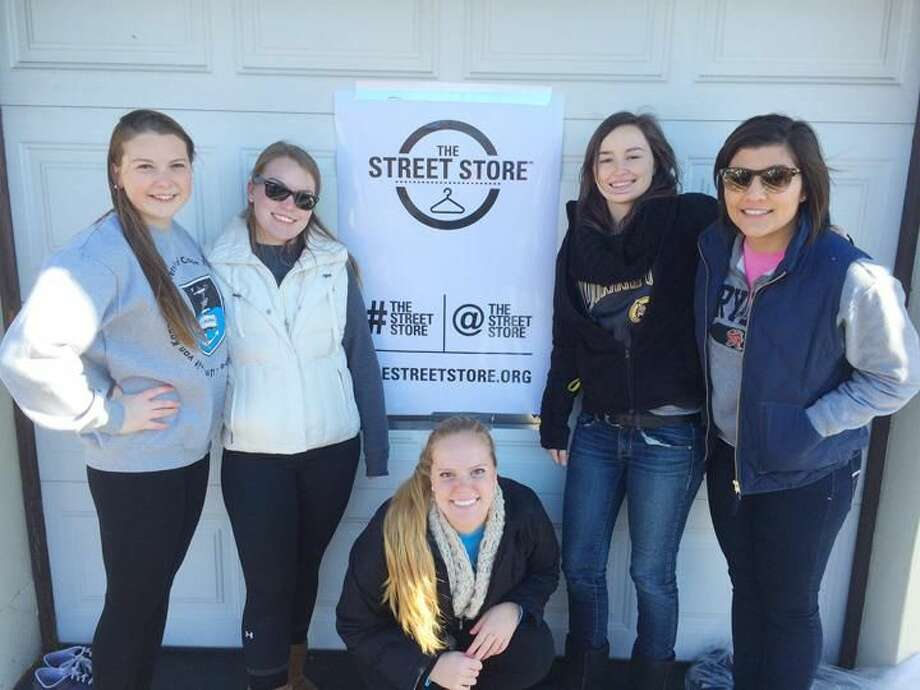 Submitted Photo Quinnipiac University students, from left, Katie Toma, Elaine Brown, Steph Hurd, Ashley Hiep and Camille Bova, took part in the Nov. 15 Street Store to provide free clothing to those in need at St. Ann's Church in Hamden.