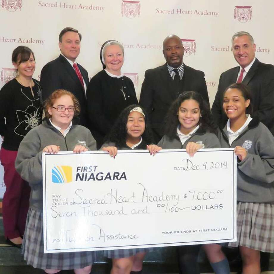 Submitted Photo Pictured are SHA students Carissa D'Agostino, Channelle Fuentes, Shelsey Vega, and Ibelkis Tejada Matos; back row: Sacred Heart Business Manager Maria Cammarota of Wallingford, First Niagara Senior Vice President James Bzdyra of Glastonbury; SHA President Sr. Sheila O'Neill, ASCJ, Ph.D., of Hamden; First Niagara Branch Manager Duke Johnson of Hamden and First Niagara Business Banking Relationship Manager Peter Thomas of Madison.