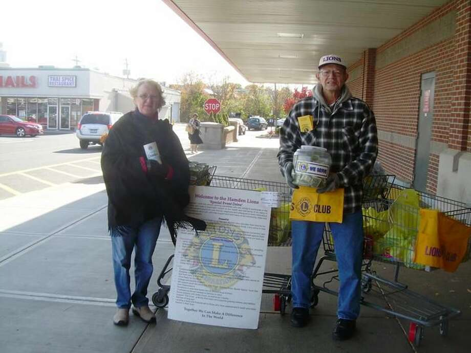 Submitted Photo Members of the Hamden Lions Club conduct thier annual Thanksgiving Food Drive at the Shop Rite Supermarket at the Hamden Plaza.