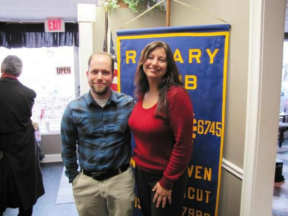Photo courtesy of David Marchesseault, Club Secretary Bone Marrow Donnor Mike Feinberg is thanked by Past President of the North Haven Rotary Club, Theresa Ranciato-Viele.