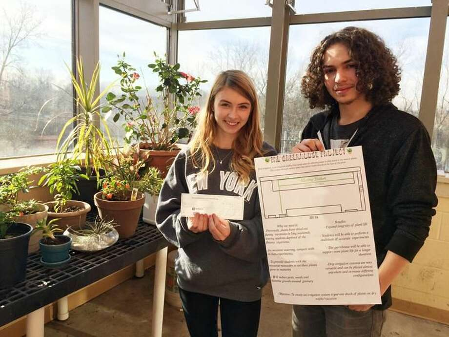 Submitted Photo North Haven High School students, Corrine Myjak and John Gildart, designed an irrigation system funded by The North Haven Education Foundation Inc.