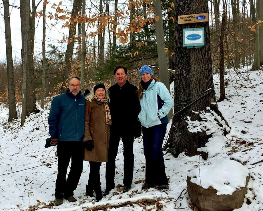 Hamden Land Conservation Trust President Jim Sirch, Rocky Top neighbors Roberta Mack and Tim Mack and Connecticut Forest and Park Association Land Conservation Director Lindsay Suhr.