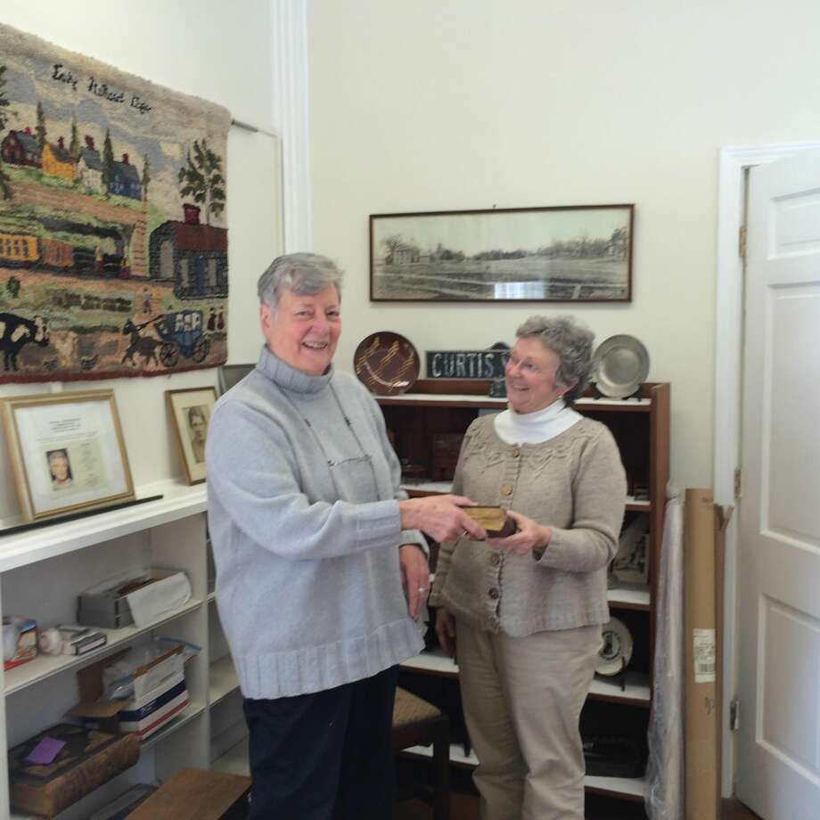 Julie Hulten, right, an archivist with the North Haven Historical Society, gratefully accepted several noteworthy donations from Shelley Beason, Sheldon Thorpe's great-great-granddaughter. Beason, who traveled from her North Carolina home to visit friends in Connecticut last week, was glad to gift the Society with treasures that once belonged to one of the town's most notable early residents. (Photo by Lynn Fredricksen)