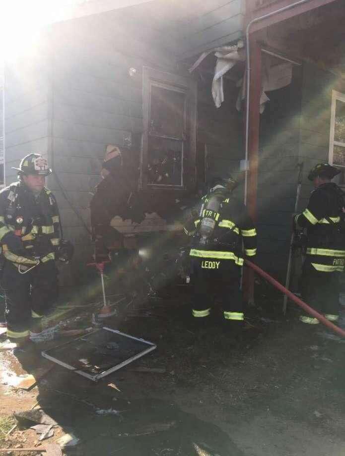 Hamden firefighters battle the blaze.