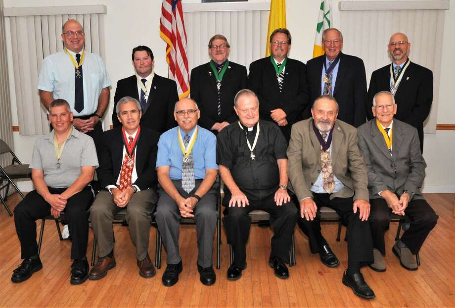 Pictured from L-R in the First Row are: Richard DePonte, Outside Guard; Blaise Vece, Warden; John Rubino, Financial Secretary, Reverend Timothy Meehan, Chaplain; Stuart Lyon, Grand Knight; Larry Esposito, Advocate. Pictured from L-R in the Second Row are: Mike Zagata, Recorder; Anthony Caiafa, Inside Guard; Nate Vestal, Trustee; Jim Dacey, Trustee; Harry Bahls, Deputy Grand Knight and Paul Caiafa, Chancellor. Not present were Robert Brancato, Treasurer and David Gianotti, Trustee.