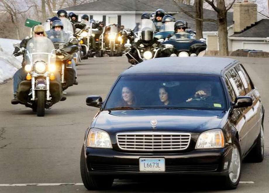 """Photo by Melanie Stengel The funeral procession of Jospeh """"Ho-Jo"""" Ferraiolo including members of the Outlaw Motorcycle Club of Waterbury approaches St. Therese's Church in North Haven Saturday, Feb. 21."""