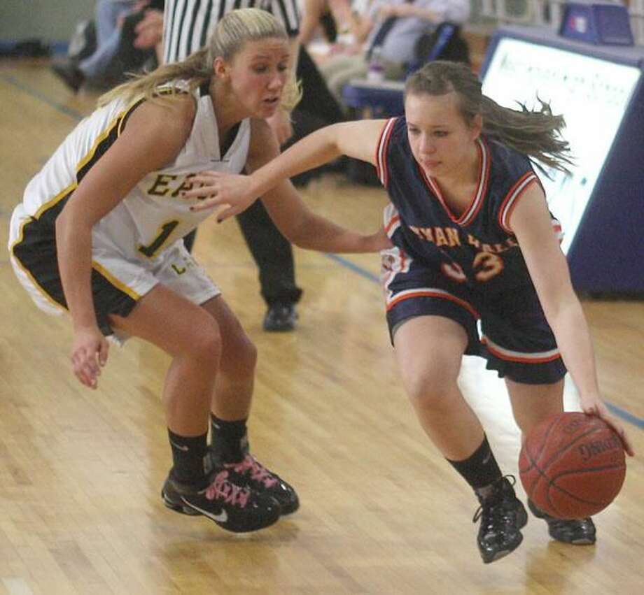 Lyman Hall's Mary Baker dribbles past Law's Casey Dulin in Saturday's quarterfinal victory in West Haven. (Photo by Russ McCreven)
