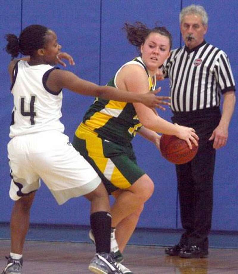Hamden's Molly Deroy looks to pass in the Dragons' 68-58 loss to top-seeded Hillhouse in the SCC quarterfinals. Deroy led Hamden past Guilford, 83-55, in the opening round and finished with 30 points and 15 rebounds. (Photo by Russ McCreven)