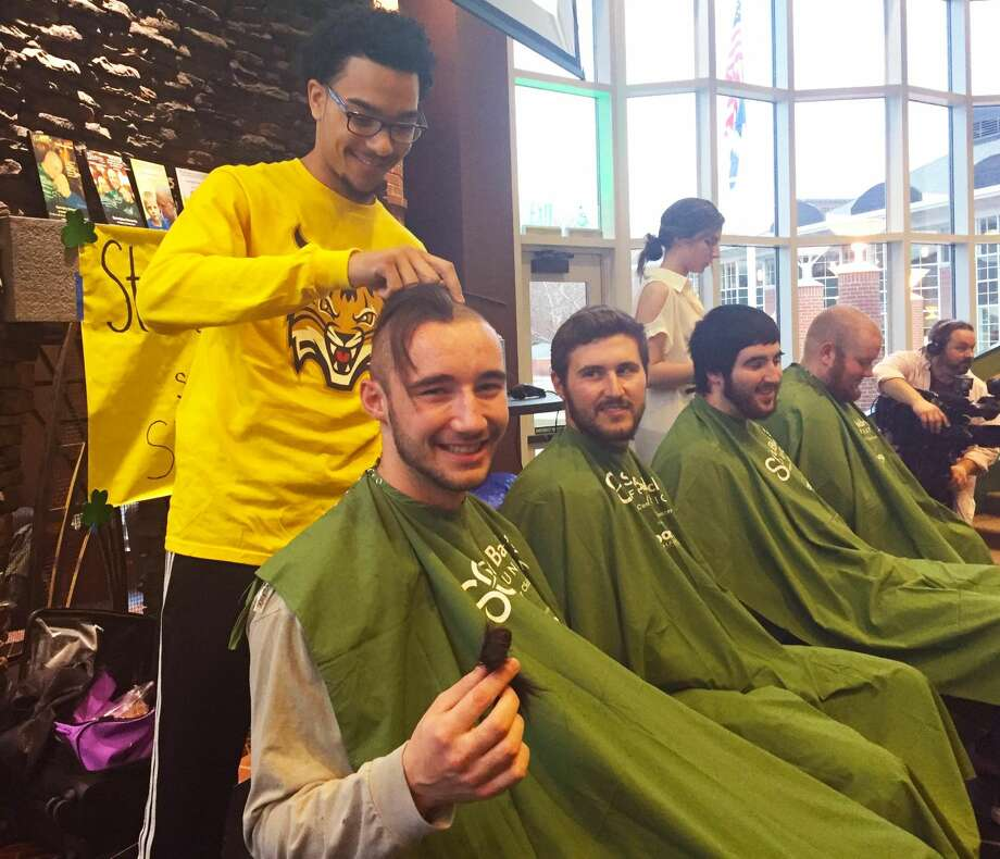 Steve McCormack, a senior from Harrisville, Rhode Island, shows off some of his freshly shorn locks while getting his head shaved at Quinnipiac University on March 8 to bring awareness to childhood cancer. Proceeds will go to the St. Baldrick's Foundation, a charitable organization funding childhood cancer research. (Contributed photo)