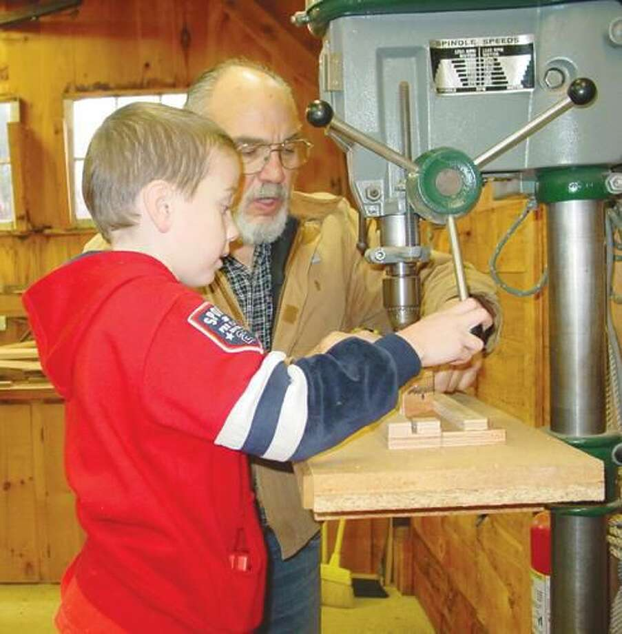 Submitted Photo Nick Iannone with his grandson Adam while working on a Cub Scout project.