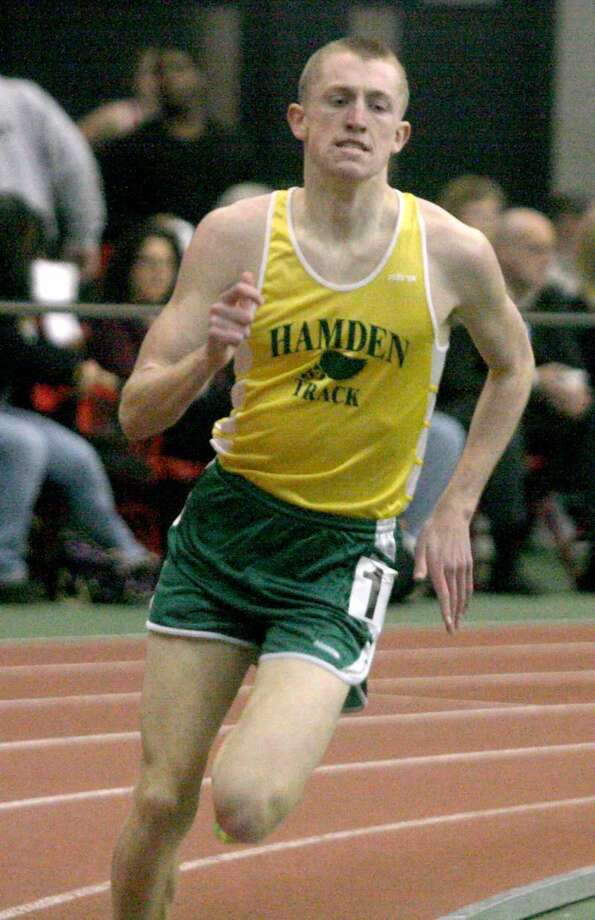 Chris FitzSimons helped lead the Hamden indoor boys track team to its first SCC championship title last Friday in New Haven. Hamden placed first with 100 points, while Amity was second with 77. (Photo by Russ McCreven)