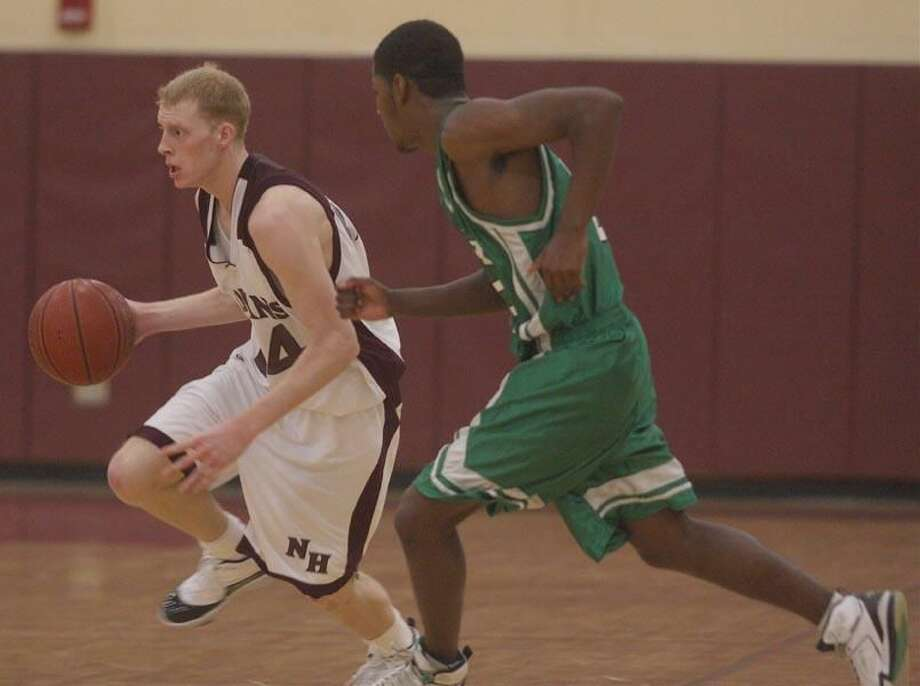 Joe Setaro dribbles past a Wilby player in North Haven's season-ending 58-53 loss. (Photo by Russ McCreven)