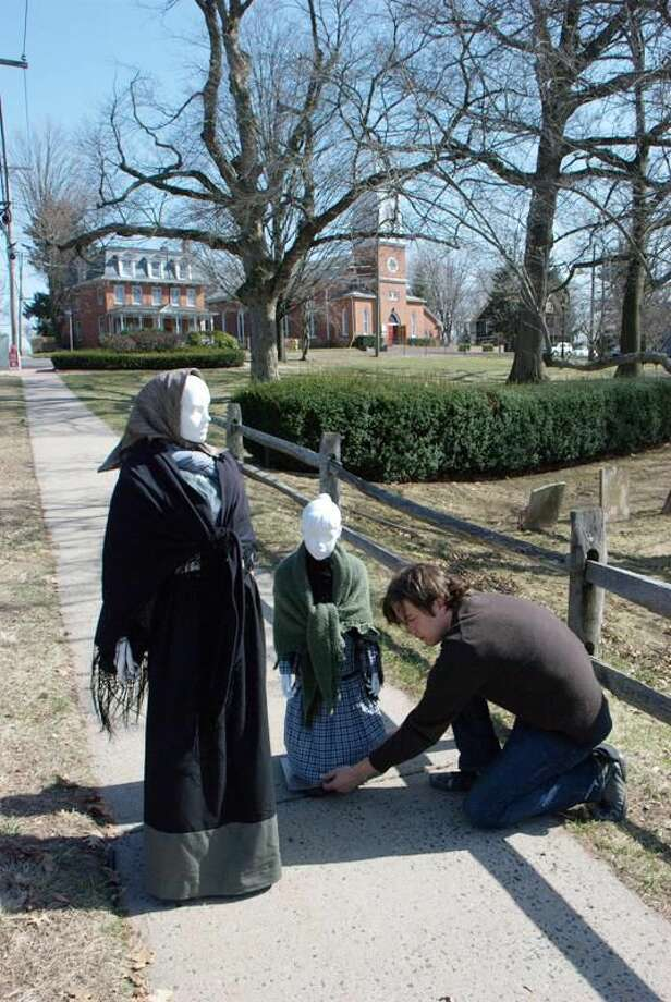 Submitted Photo Stefano Gagliarducci sets up his mannequins for a photograph on St. John Street. The adult mannequin represents his great-grandmother Teresa Grossi. The child mannequin represents his grandmother, Silvia Boroli.