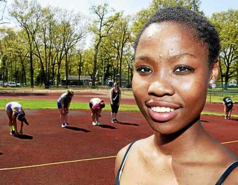 Peter Hvizdak — New Haven Register Erica, a 15-year-old North Haven High School student who is looking for a family to adopt her, with her high school track team Thursday, May 12.