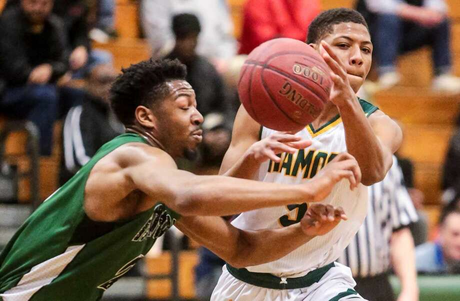 Hamden's Ronnie Ellis battles for loose ball with Bassick's Jaelin Gallimore during Tuesday night's game in Hamden.
