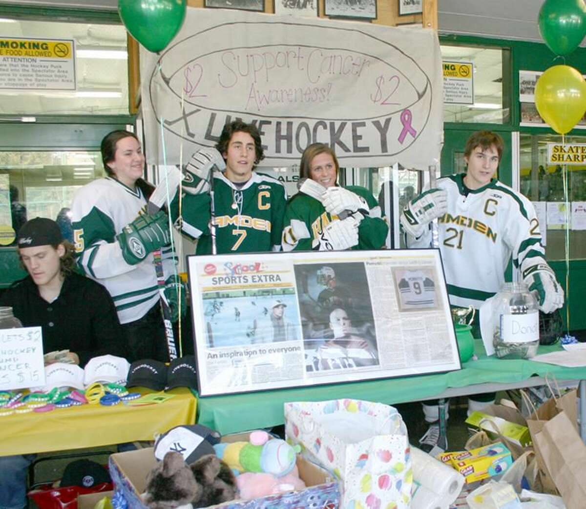 """Pictured from left to right with donations are: Mike Dalhuisen from """"LIVEHOCKEY,"""" girls assistant captain Emily Orser, and boys and girls captains P.J. Vakos, LeeAnn Esposito, and John Teulings. Bobby Ugolik was the program chairman. (Submitted photo)"""