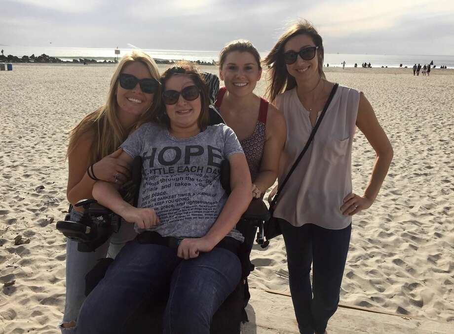From left to right are  Devin Latremore, Emily Frey,  Amanda Syme and Alex Bode, front left, visiting in San Diego. Bode has filed a complaint with JetBlue with the U.S. Department of Transportation.