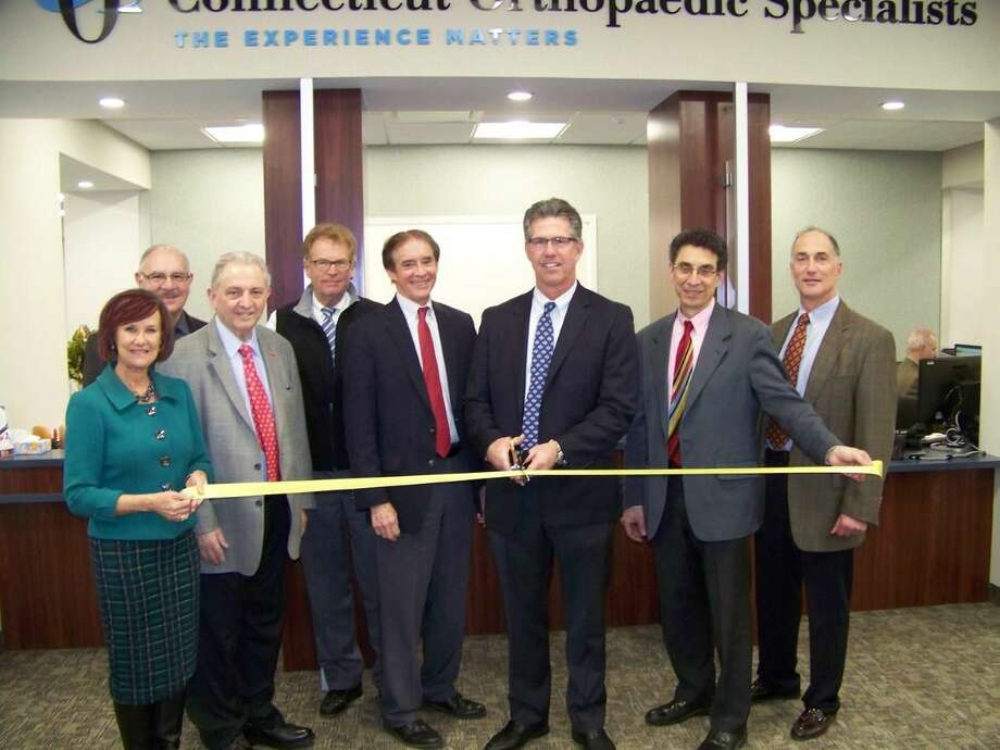 From left, Dee Prior-Nesti - Executive Director Quinnipiac Chamber of Commerce; Joe Mirra - Wallingford EDC; Dr. John Aversa - COS; Glenn Elia - CEO COS; William Dickinson - Mayor of Wallingford; Dr. Patrick Ruwe - President of COS Board of Directors; Dr. Alan Reznik - COS; Dr. John McCallum - COS.