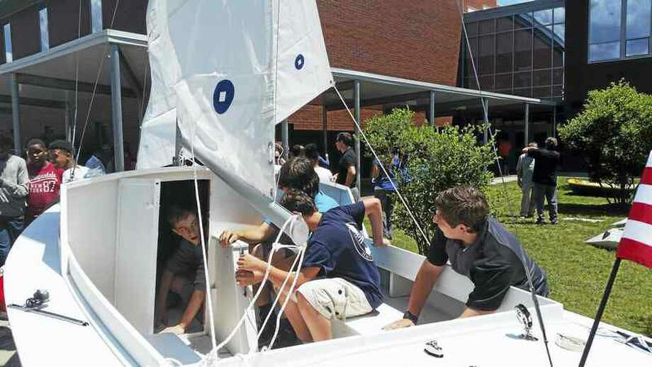 Kate Ramunni, New Haven Register Students check out the sailboat constructed as part of Hamden Middle School's Navigator program.