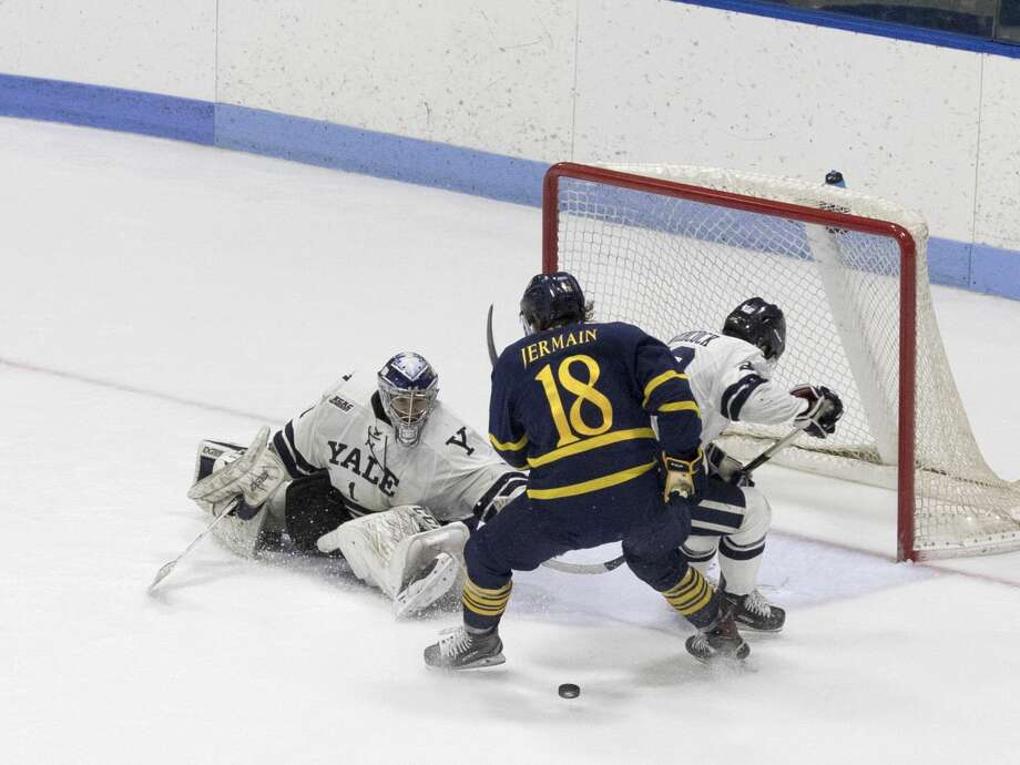 Yale goalie Sam Tucker makes a save in the third period against Quinnipiac on Friday.
