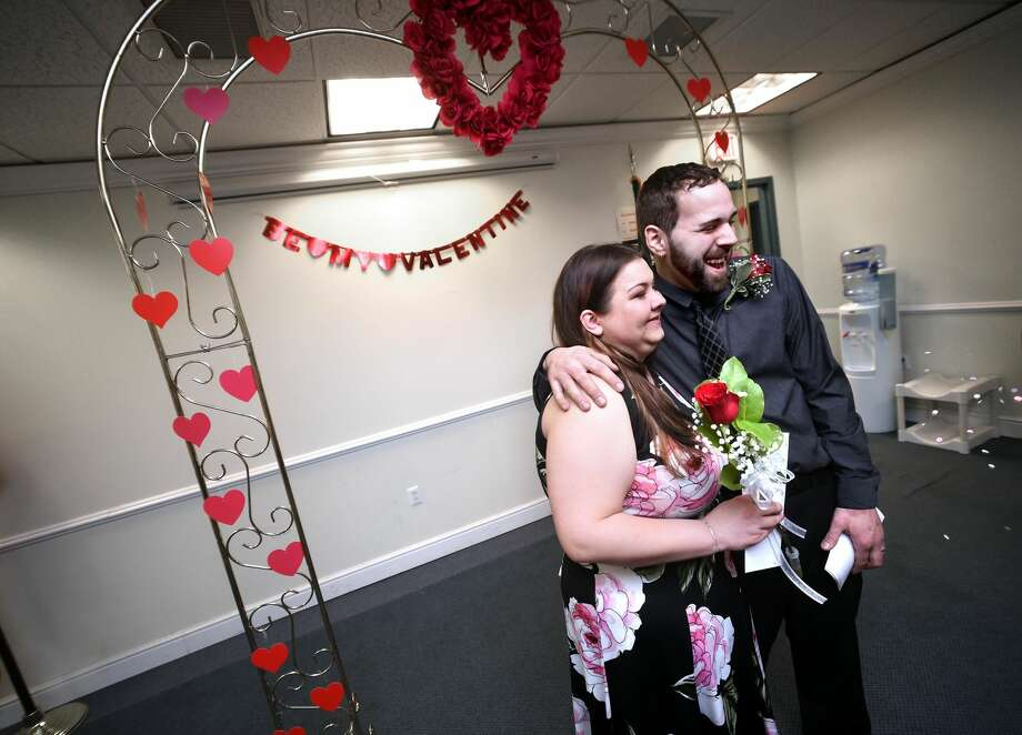 Jessica Vespoli and William Leonardo pose for photographs after being married at the Hamden Government Center during the 20th Annual Valentine's Day Ceremonies on Feb. 14.