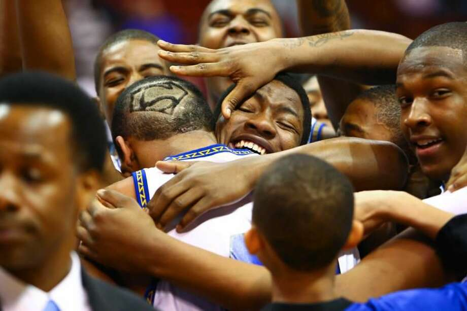 Members of the Hyde boys' basketball team celebrate after beating Prince Tech to win the Class S championship on Saturday. (Photo by Chase Smith)