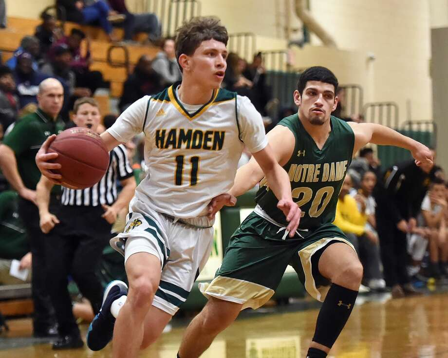 Hamden's Victor Rosario drives past Notre Dame-West Haven's Evan Blue during Friday's game in Hamden.