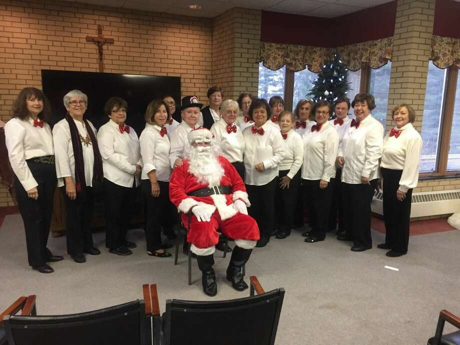 The Hamden Woman's Club chorale group performs, with Santa in attendance.