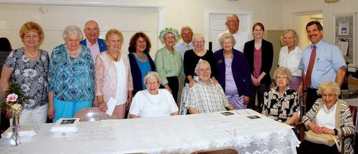 Photo by Martha Butterworth Seated from left, Audrey Tilley, Ed Dudley, Ruth Dudley, and Mary Cestaro. Standing from left, Linda Lacobelli, Joyce Bellonio, Curtis Andrews Sr., Elfie Hummel, Merrilee Gladkosky, Doris Ferner, Bernard Hummel, Ellie Harple, Eleanor Norback, Bryant Munson, Laura Gardocki (representing her grandfather Russell Hoyt), Lillian Flodquist, and Rev. Scott Morrow, who is in his 22nd year serving the church.