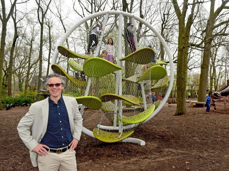 Spencer Luckey, of Luckey Climbers, a playground designer, next to one of his creations at the Foote School in New Haven.