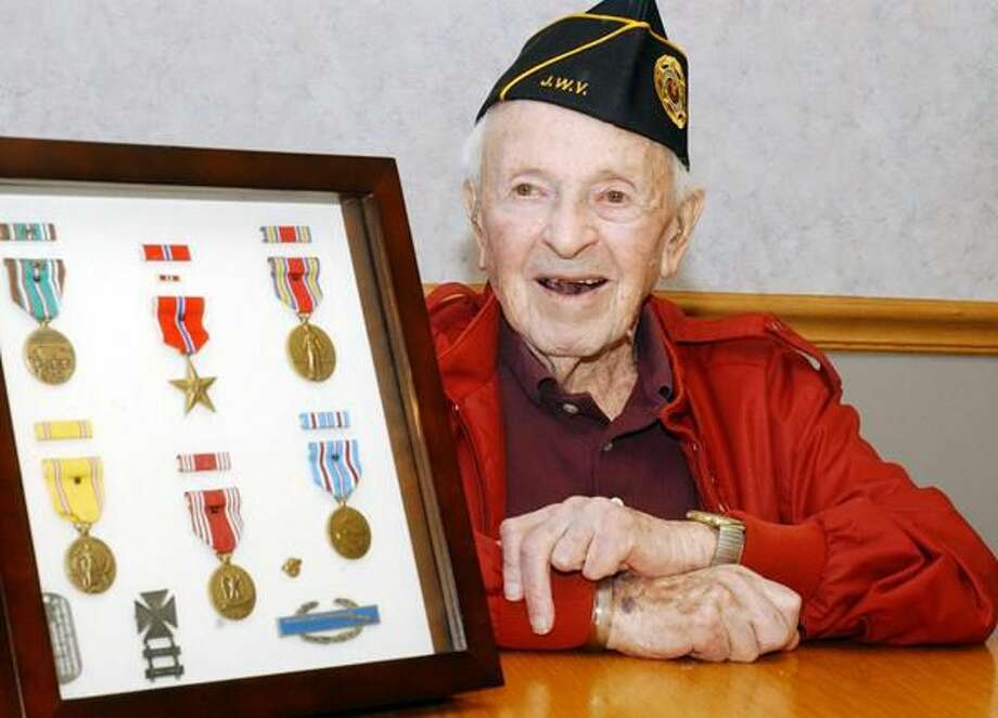Photos by Mara Lavitt The Jewish War Veterans Post 204 Hamden met for their monthly meeting at Arden House to honor member Joe Lukacs, pictured here with his service medals. Lukacs is turning 100 this month.