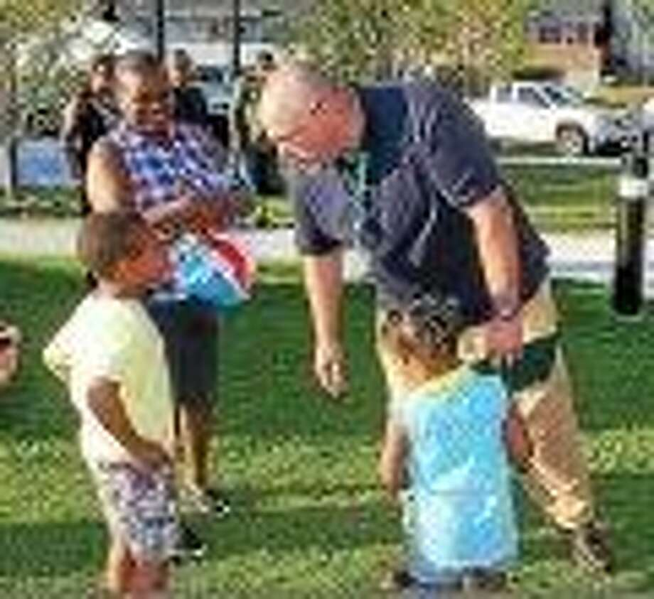 Photo by Kate Ramunni, New Haven Register Mayor Curt Balzano Leng talks to kids Tuesday night at National Night Out in Hamden.