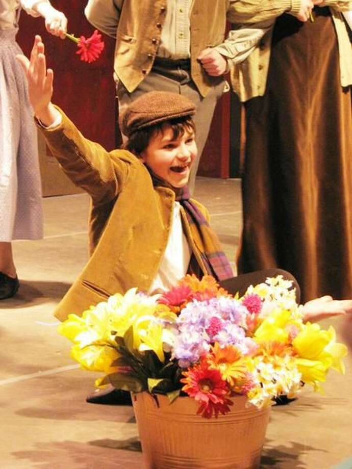 "Submitted Photo Dickon (Michael Luszczak) invites everyone to ""Take a Flower to the Fair"" in Newington Children's Theatre production of ""The Secret Garden."""