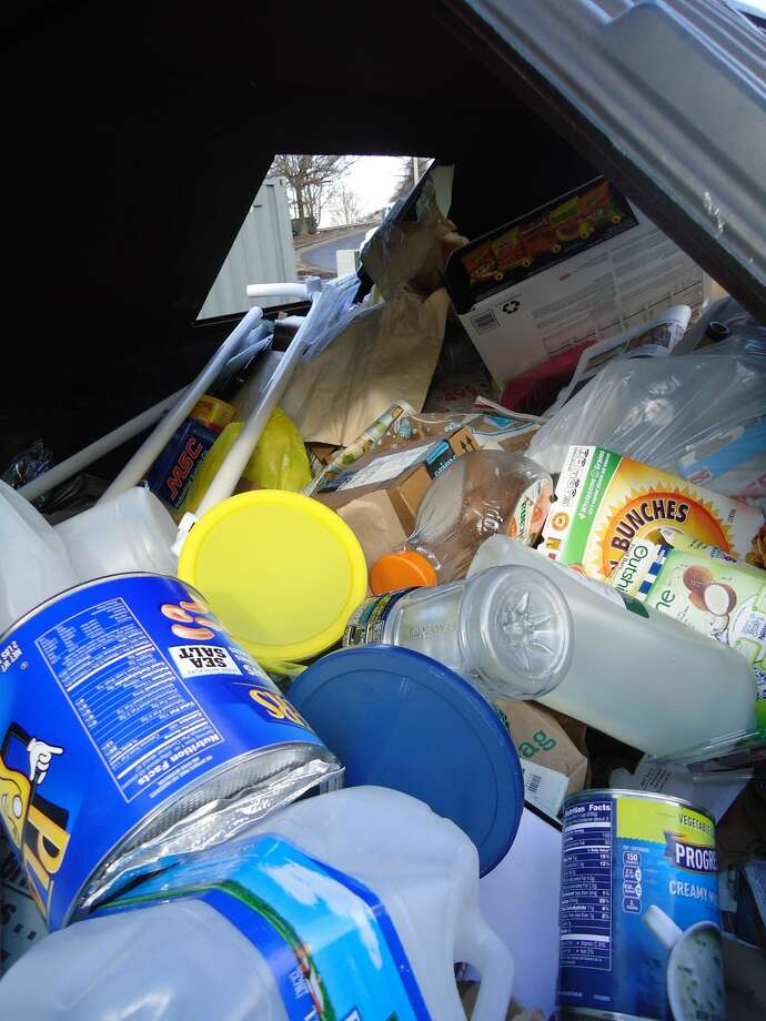 The recycling container in the Stratford Transfer Station on Watson Boulevard. Many of the items here can't be recycled, such as the plastic bags and the PVC pipe.