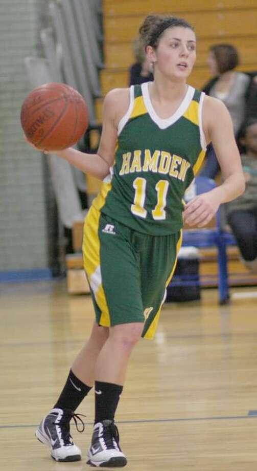 Hamden's Cara Deroy brings the ball upcourt during the recent SCC tournament. Deroy scored 25 points to lead Hamden to a 56-42 first-round victory over New Britain in the Class LL state tournament. She also had 25 points in the Dragons' season-ending 65-62 loss to Career-New Haven in the second round. (Photo by Russ McCreven)