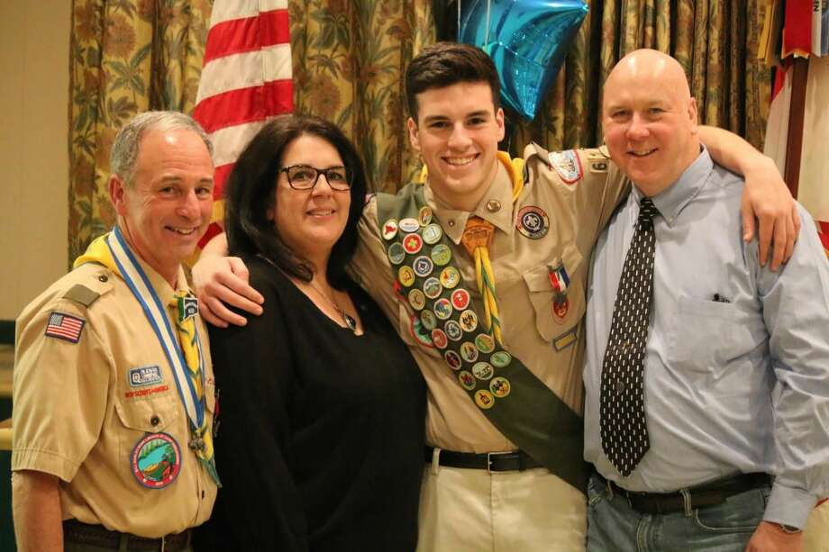Eagle Scout James Kearney with parents Michele and Jim Kearney and Scoutmaster Bill Earley.