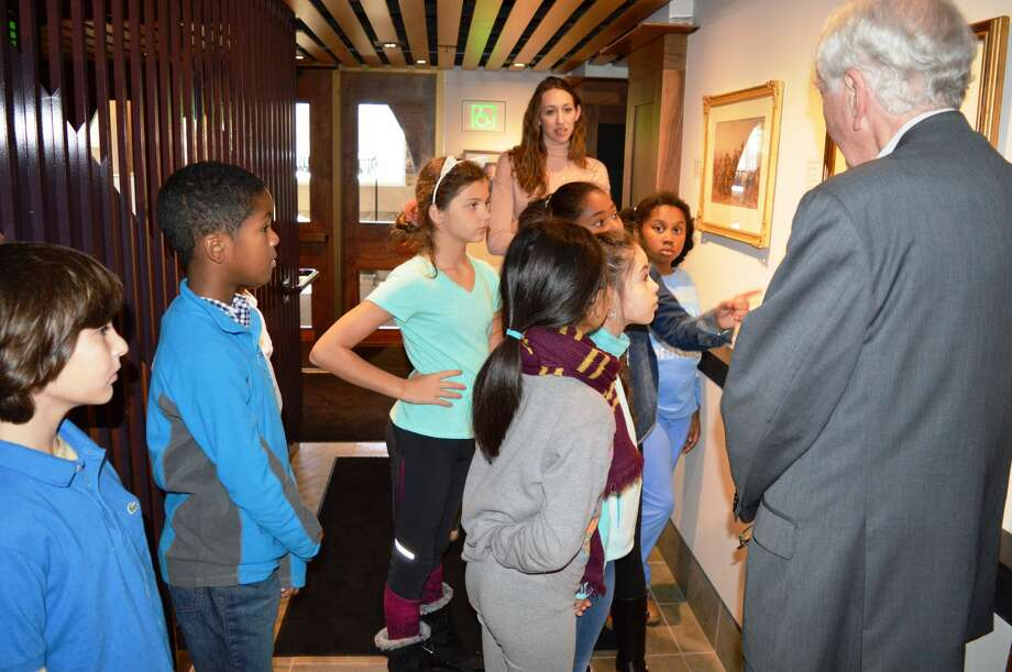 Hamden Hall Country Day School fourth-graders learn about the Irish potato famine from a docent at Ireland's Great Hunger Museum in Hamden.