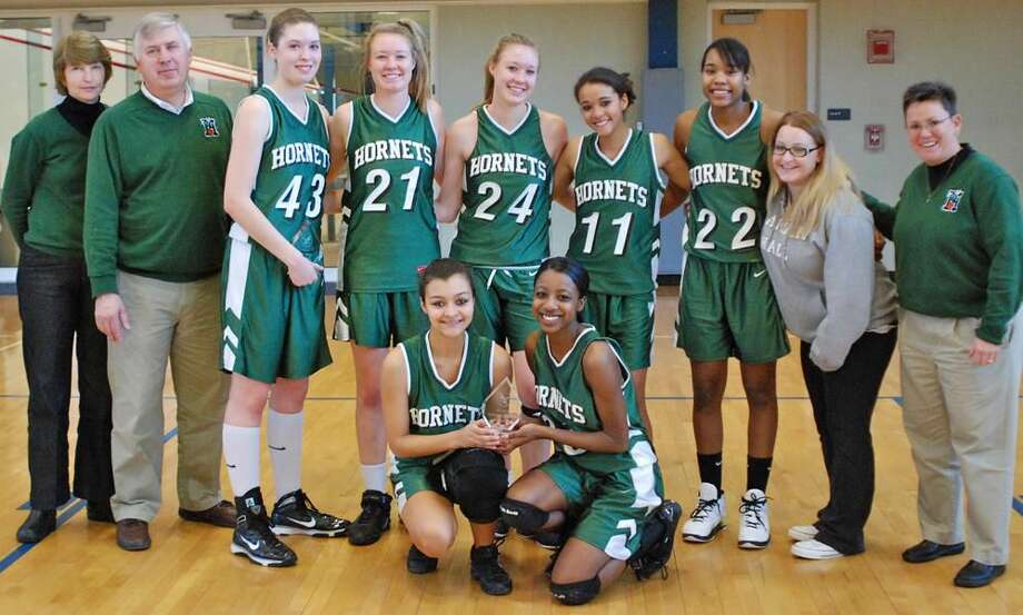The Hamden Hall girls' basketball team recently won the first title in the history of the girls' basketball program with a victory over Vermont Academy to claim the New England championship. (Submitted photo)