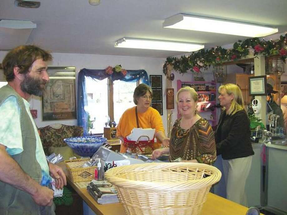 Photo by Lynn Fredricksen Customers Mike Cerasale and Lanette Barber enjoy the wares at Twice is Nice Consignments while employee Kate Nemergut and owner Kathy Scalzi look on.