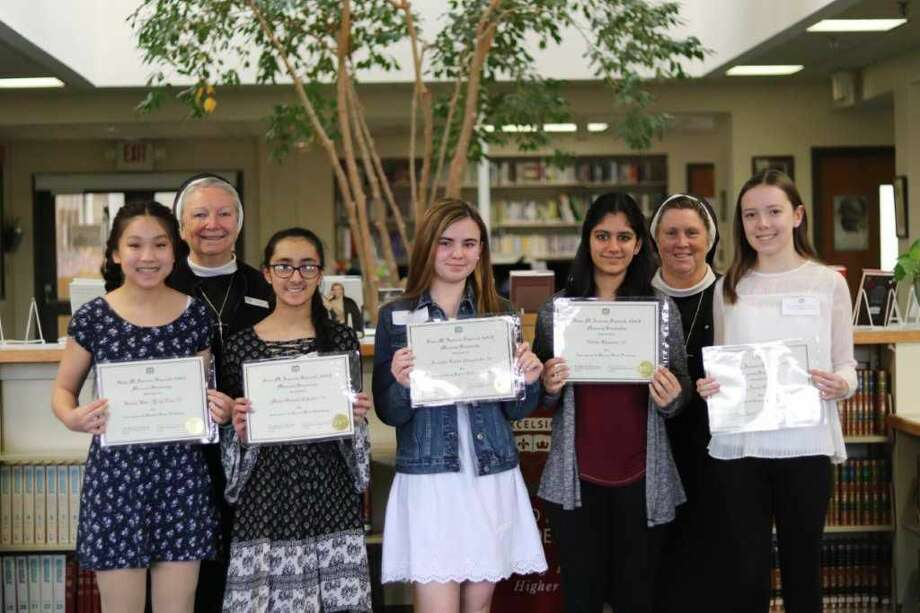 From left, Kiana Tan of Seymour, President Sr. Sheila O'Neill, ASCJ, Ph.D., '71 of Hamden, Mehr Chhatre of Hamden, Isabella Giaquinto of Hamden, Nikita Khanna of Derby, Principal Sr. Kathleen Mary Coonan, ASCJ, '76 of Hamden, and Molly O'Neill of Fairfield.