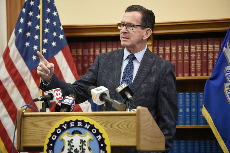 Gov. Dannel P. Malloy responds to a question during a news conference Monday at the State Capitol in Hartford, Conn., about the budget adjustments he is proposing for the 2019 fiscal year.