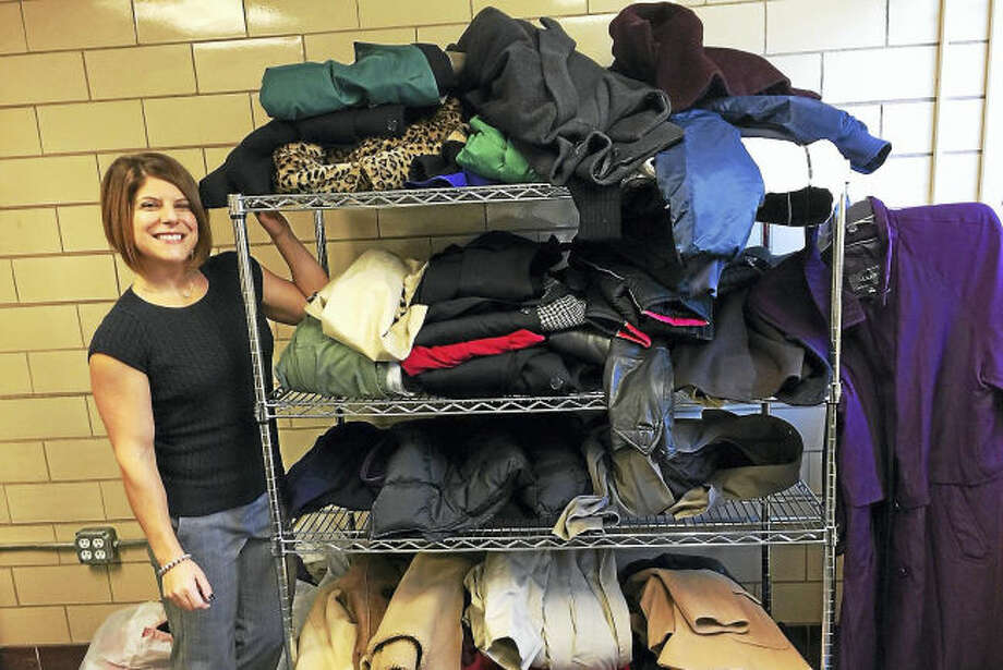 Carla Riccio, of the Community Services Department, stands with just a few of the coats collected as part of a town wide coat drive coordinated by resident Deb Zavarella, Masonic Lodge, Community Services and local schools. Any North Haven resident is welcome to come get a free coat on distribution day, Saturday, Oct. 22 at the Masonic Lodge on Church Street. For details, call Community Services at 203-239-5321.