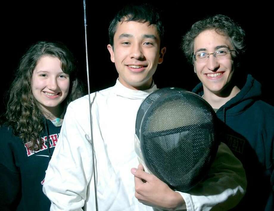 From left, Katie Roberts, Adam Lee and Jason Riggs helped lead the North Haven fencing team to a state championship. (Photo by Arnold Gold/ New Haven Register)